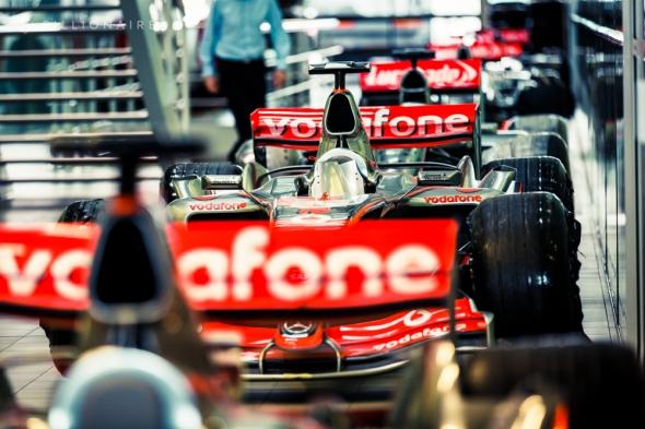 6 F1 cars sit in the corridor